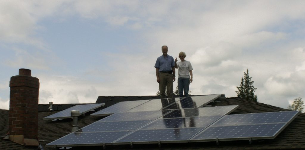 Clients Posing By Solar Array