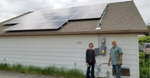 Grid Tie Solar Clients Pose with Their System